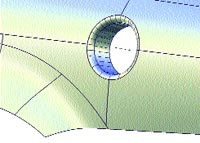 Figure 2. Then use a new feature in Alias Studio Tools 11 to add a tubular flange to the hole.
