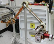 Figure 2. The robotic arm was tested in ASI's Class 10,000 cleanroom with instrument mass models attached at the end-effector.