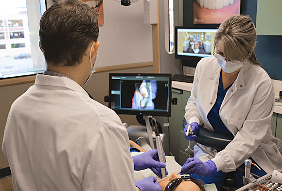 Oral surgeon Nick Marongiu, uses the 3M True Definition Scanner system to image the inside of a patient's mouth. 3M ESPE and Dr. Nick Marongiu.