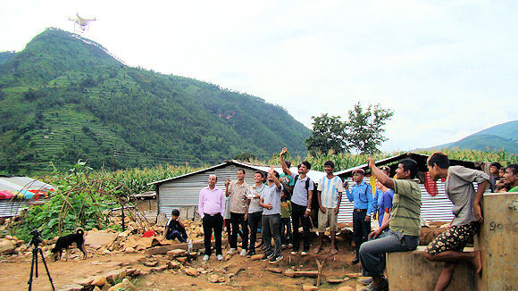 Residents of Bhimtar village greet a drone as it captures high-resolution images of the region. (Source: Build Change)